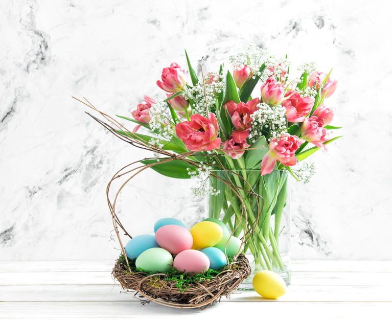 Easter eggs and pink tulips. Spring flowers with easter decoration