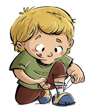 niño atandose los cordones de zapatos